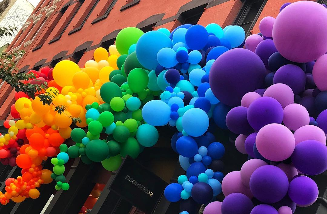 Gay Pride Rainbow Balloons Adorning a Storefront in Manhattan