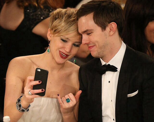 Jennifer Lawrence playing with her iPhone